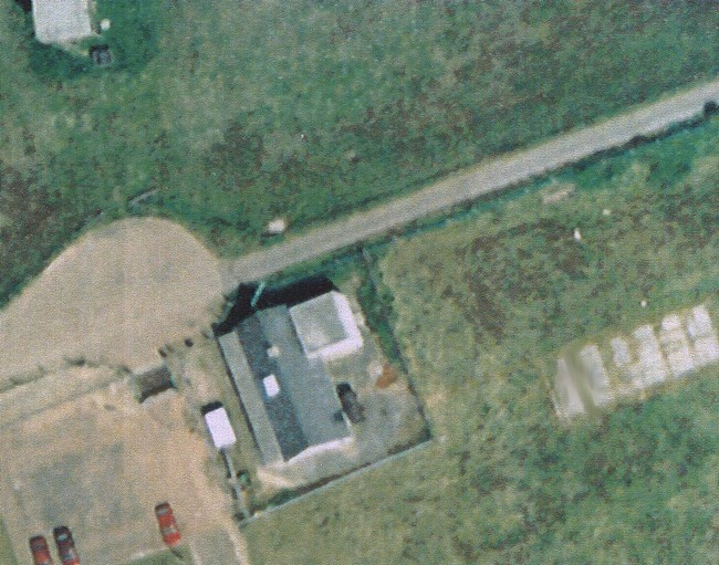 Ventnor top site bungalow and water tower. This photo was taken an unknown time after the RAF had departed.