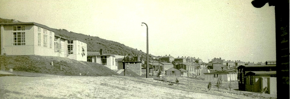 View towards the main gate, showing Cookhouse on the left and Sick Quarters on the right. Photo provided by Roy Eames
